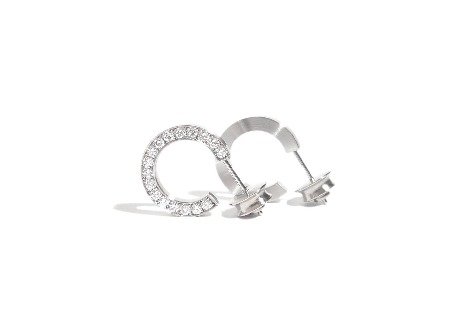 Stainless steel hoop earrings with 34 diamonds set on the side. J.9.004
