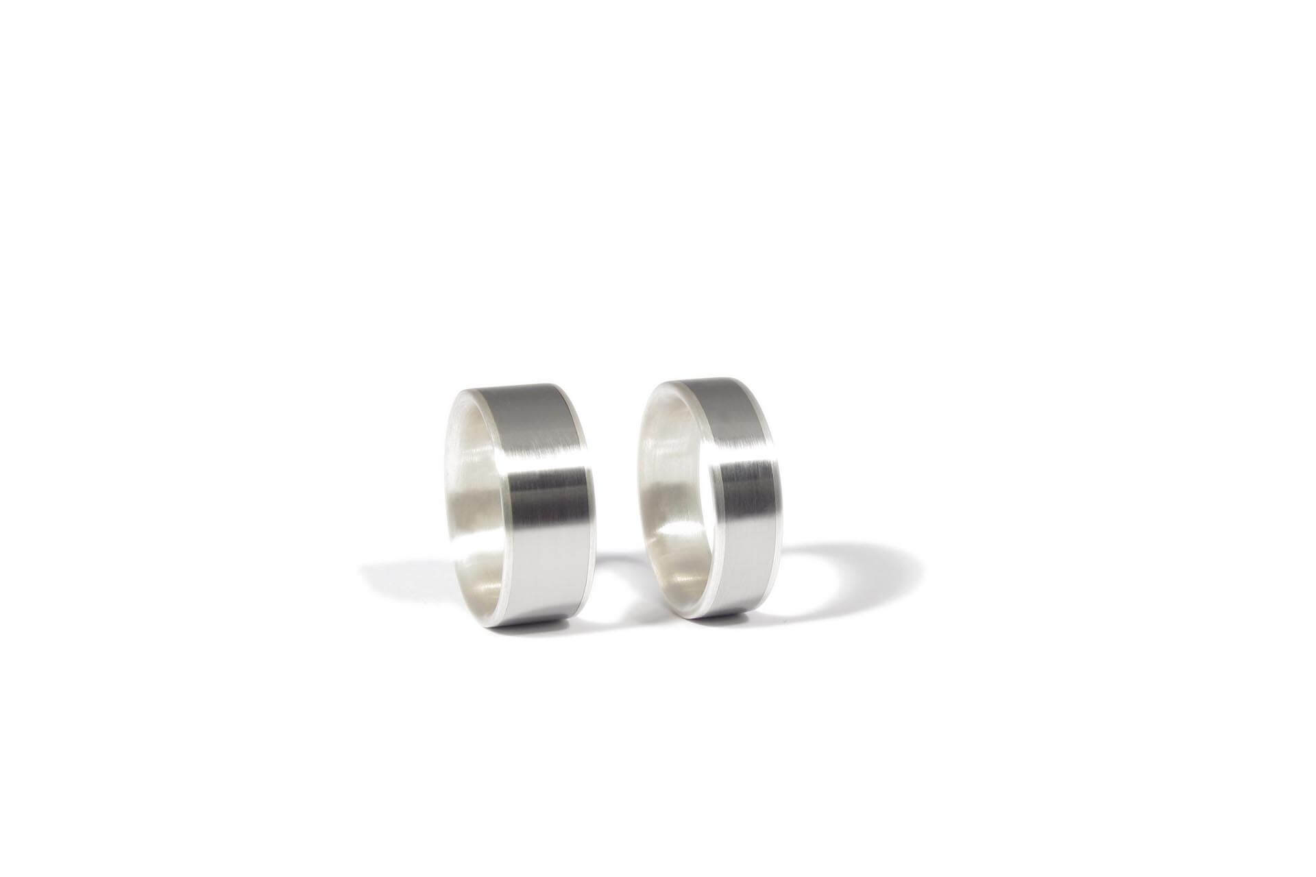 silver and stainless steel inlay wedding rings