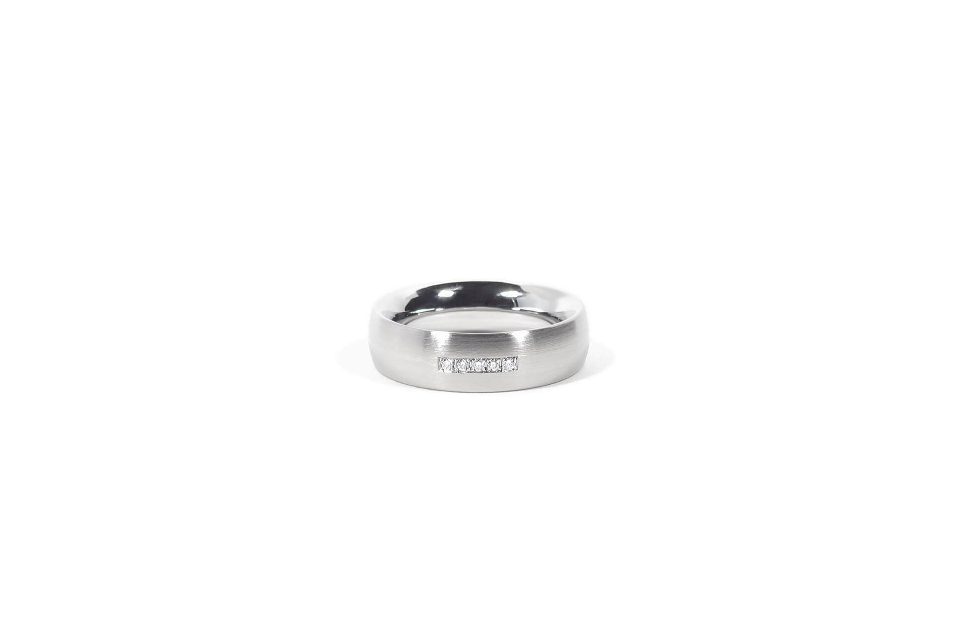 Stainless steel ring with 5 pave set diamonds. Side view. R.9.006