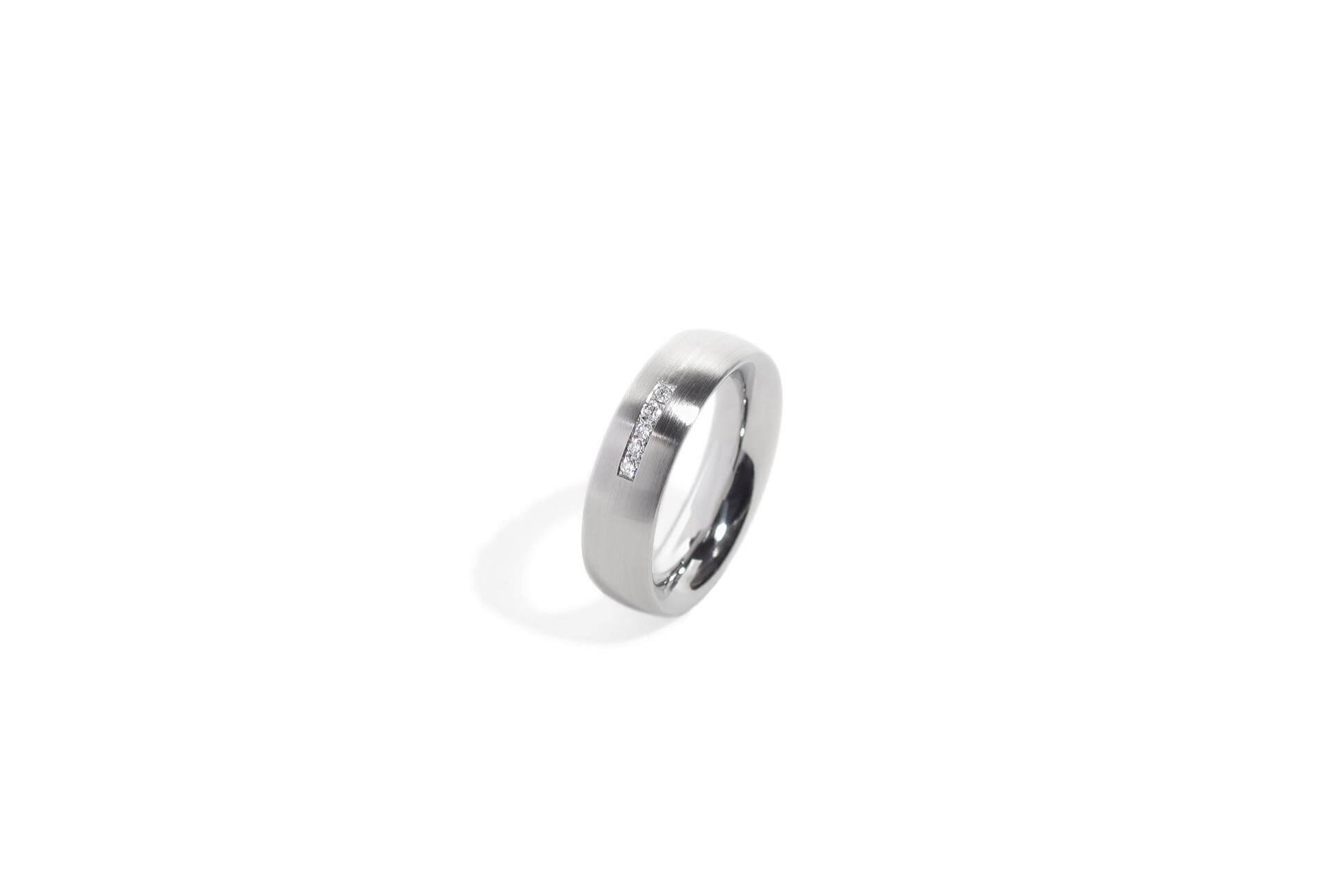 Stainless steel oval ring with 5 pave set diamonds. Top view. R.9.006