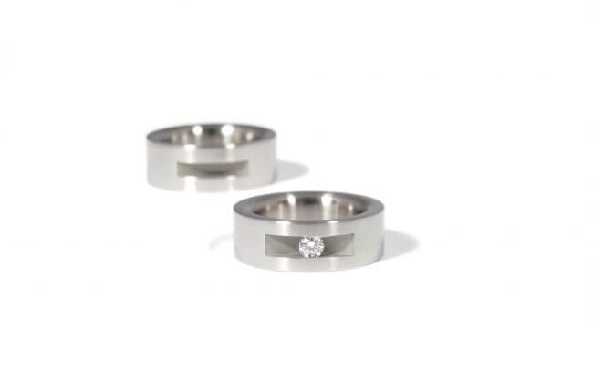Wedding rings from stainless steel and a white diamond. Side view. WR.9.005
