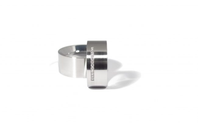 Stainless steel wedding rings with a row of diamonds. WR.9.001