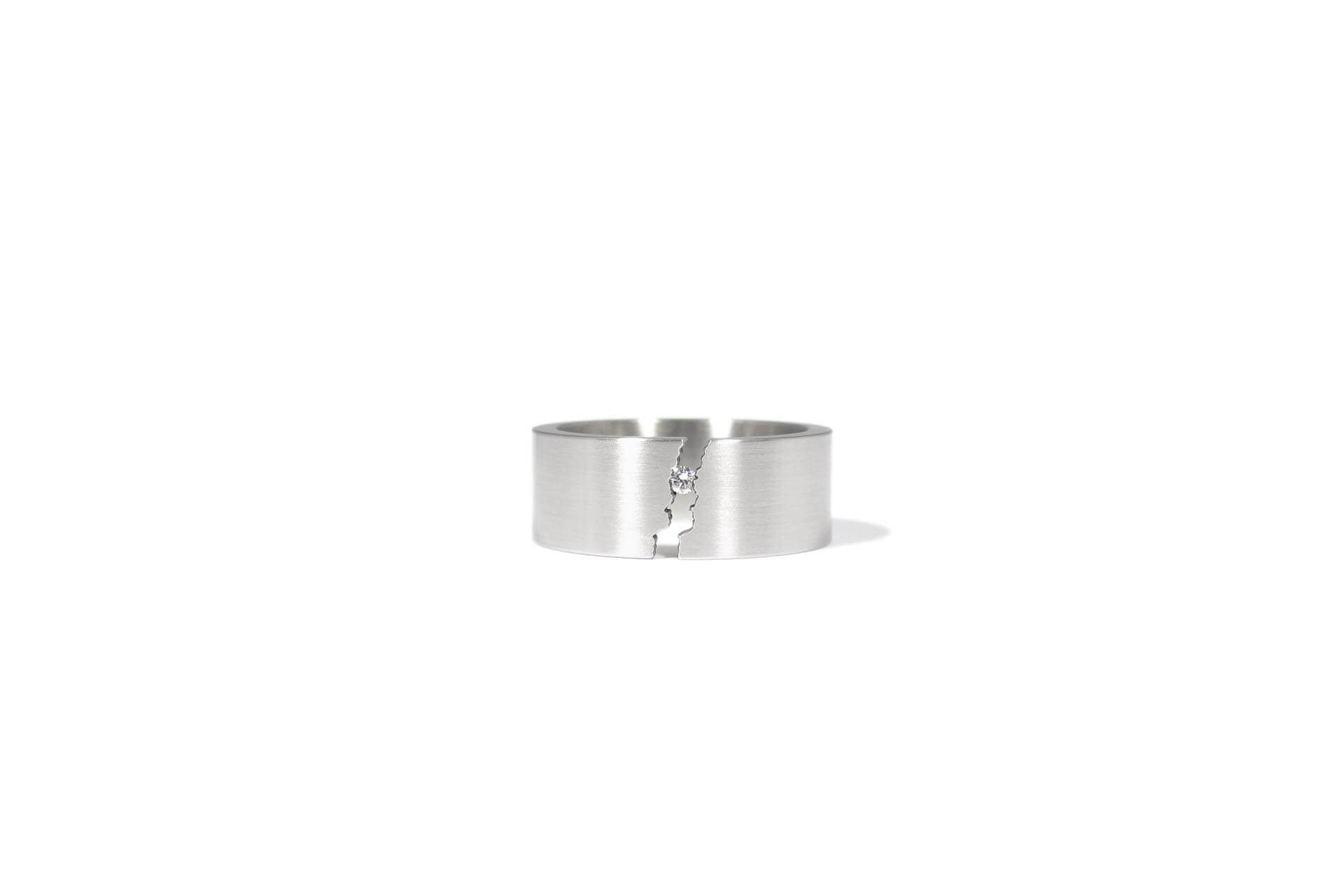 Patrick Malotki stainless steel ring with a diamond.
