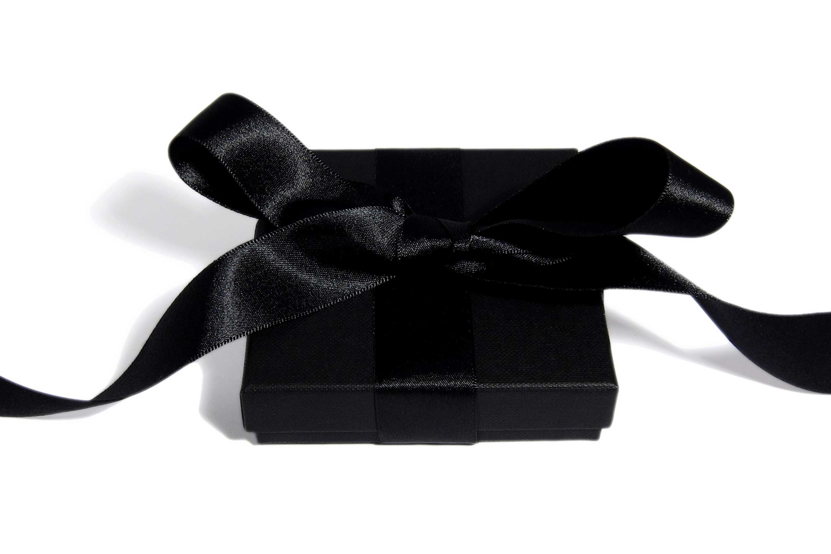 Beautiful wrapped black jewelry box in a black satin ribbon.