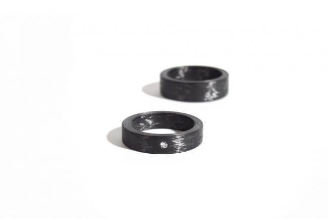 Two carbon wedding rings. Side view.