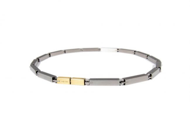 Carl Dau stainless steel necklace with gold clasp.