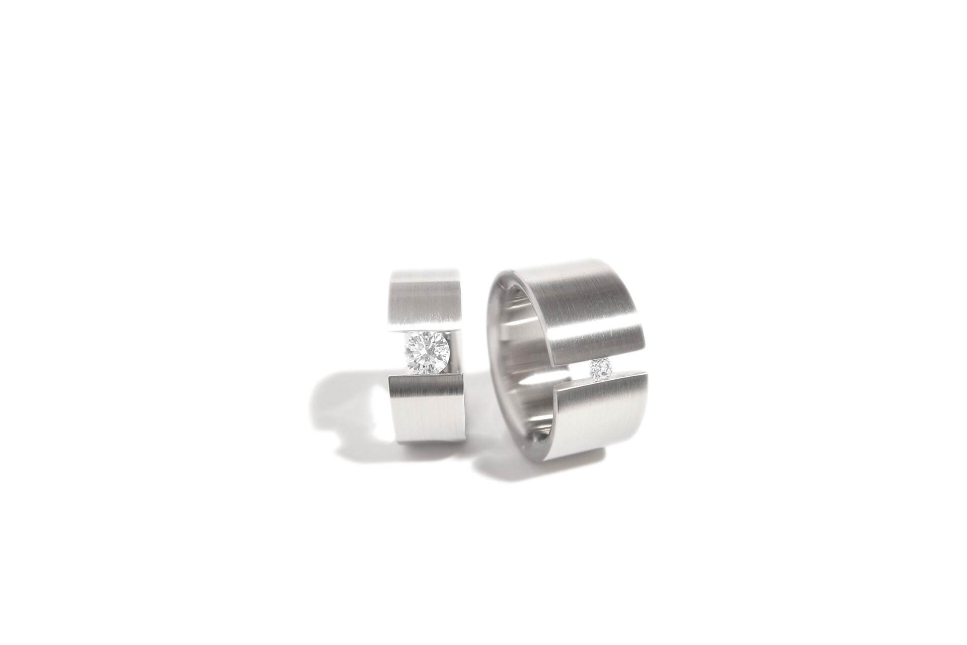 Stainless steel rings with tension set diamonds. WR.9.008