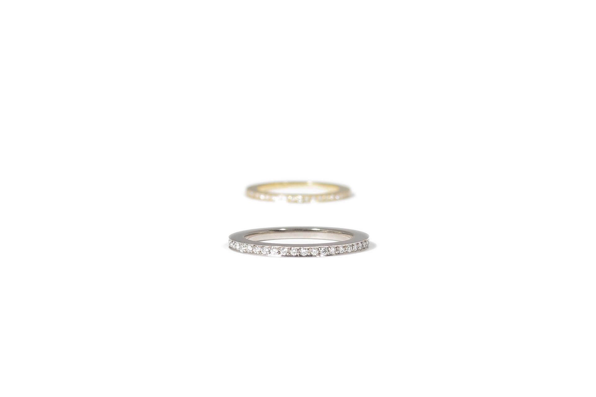 Two eternity gold rings. One in yellow gold and the other in white gold.