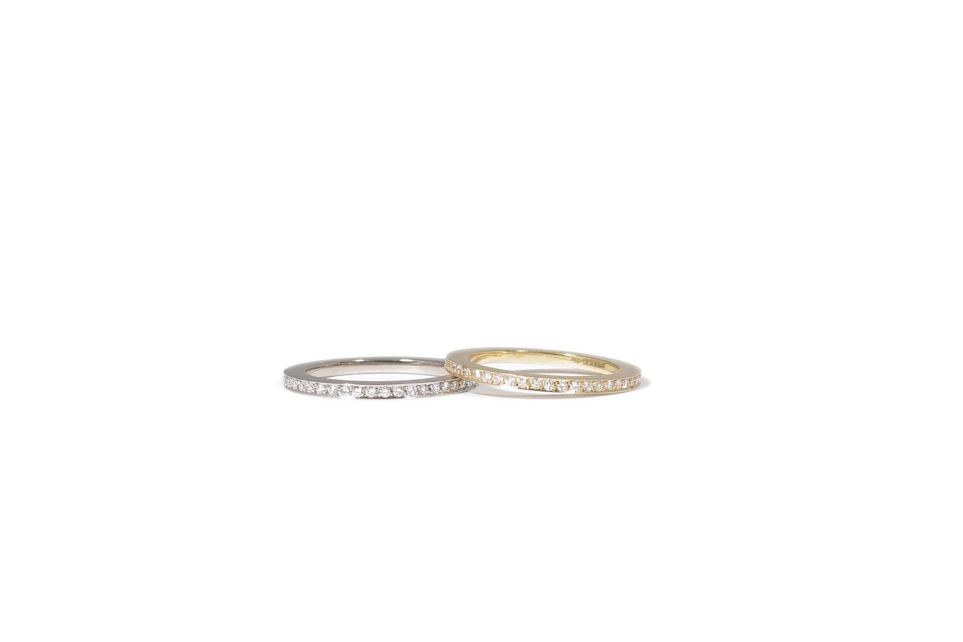 Two yellow and white gold rings with diamonds