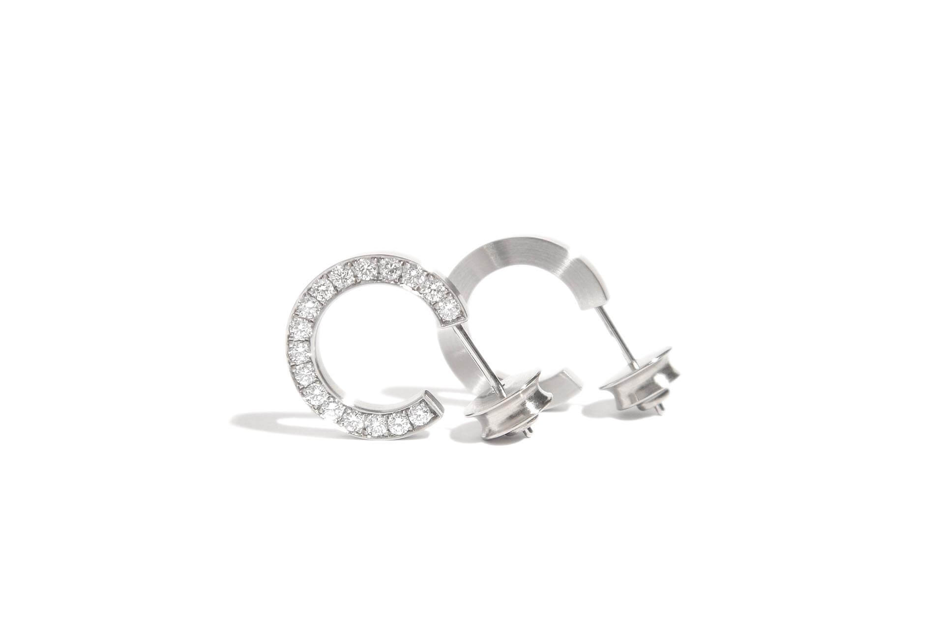 Stainless steel hoop earrings with 34 diamonds set on the side. J.9.004