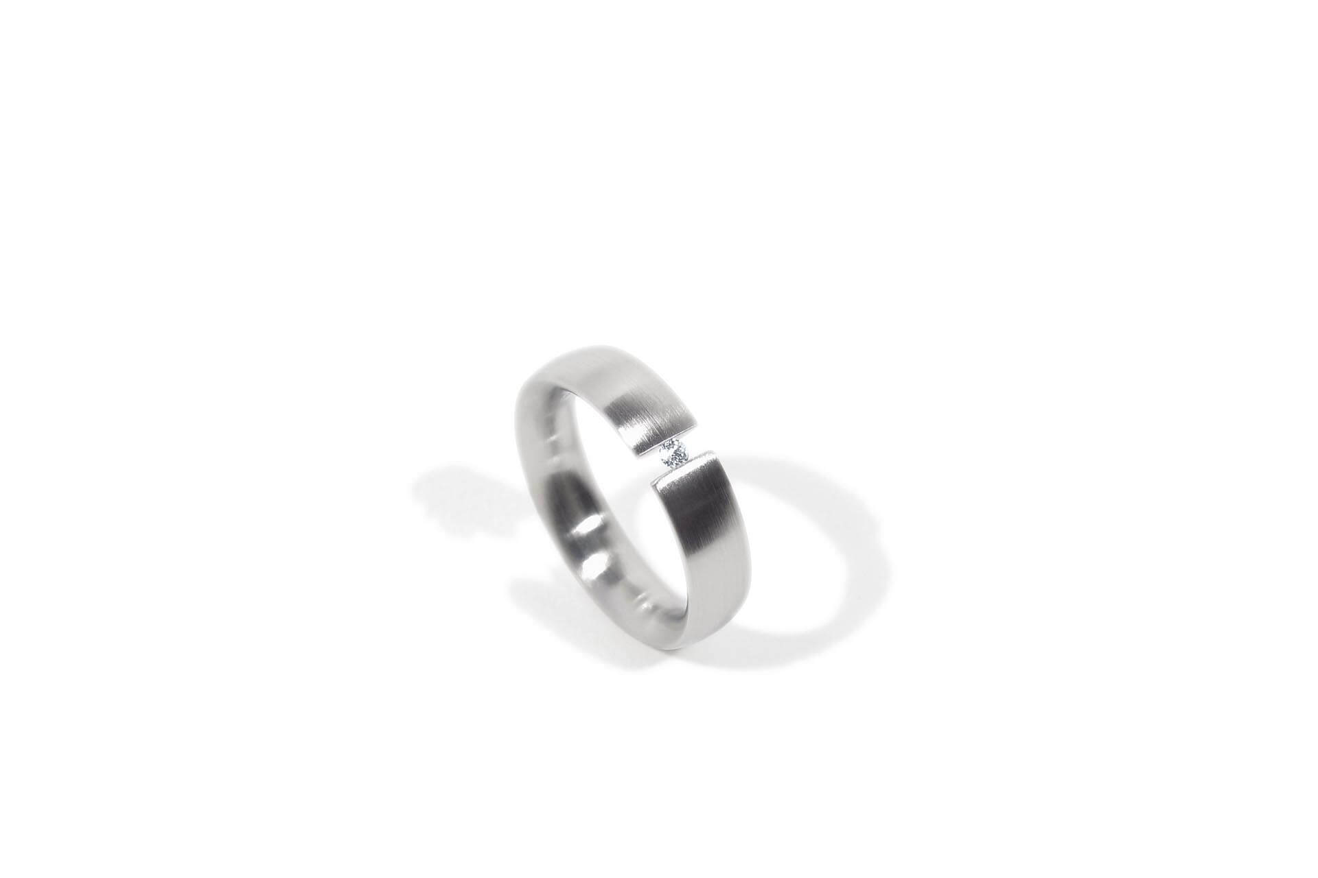 Stainless steel oval ring with a diamond. Top view of ring.