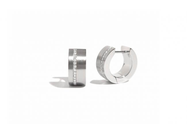 Stainless steel earrings with 30 diamonds set in a row.