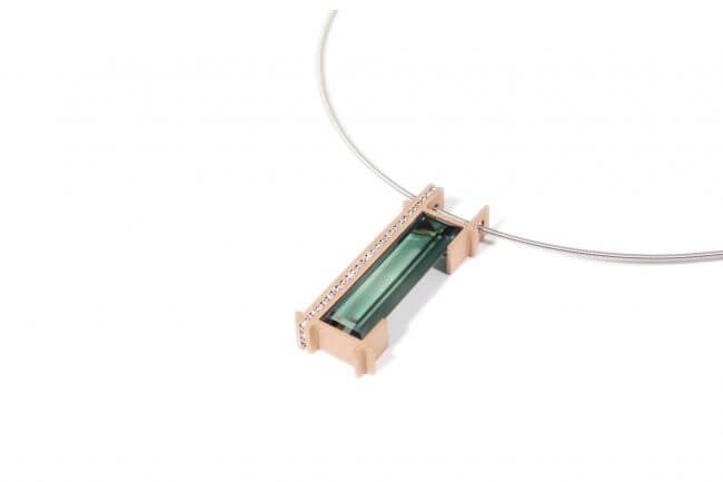 Necklace with a red gold pendant, dark green tourmaline and diamonds.