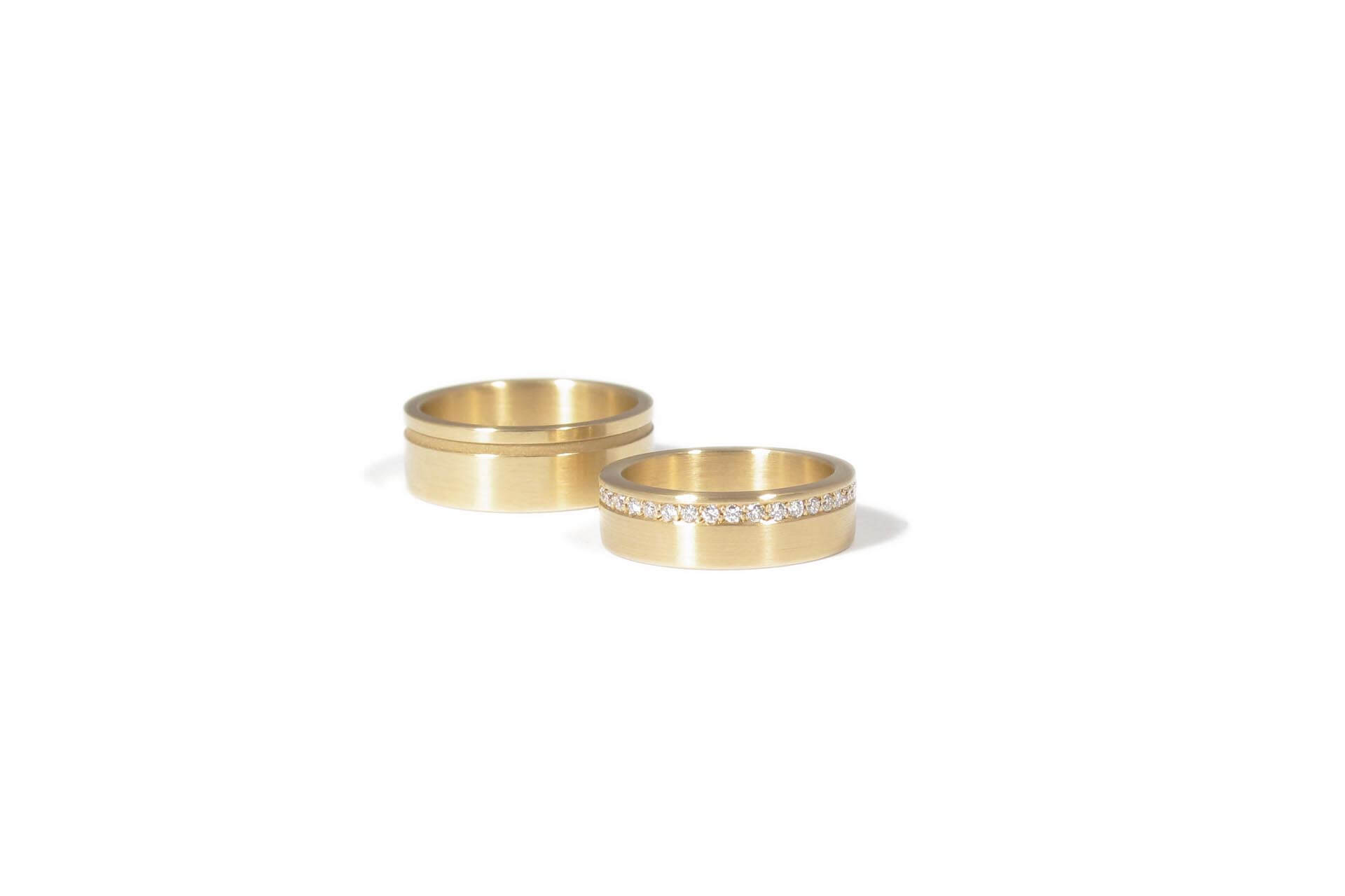 Two yellow gold rings, one with diamonds