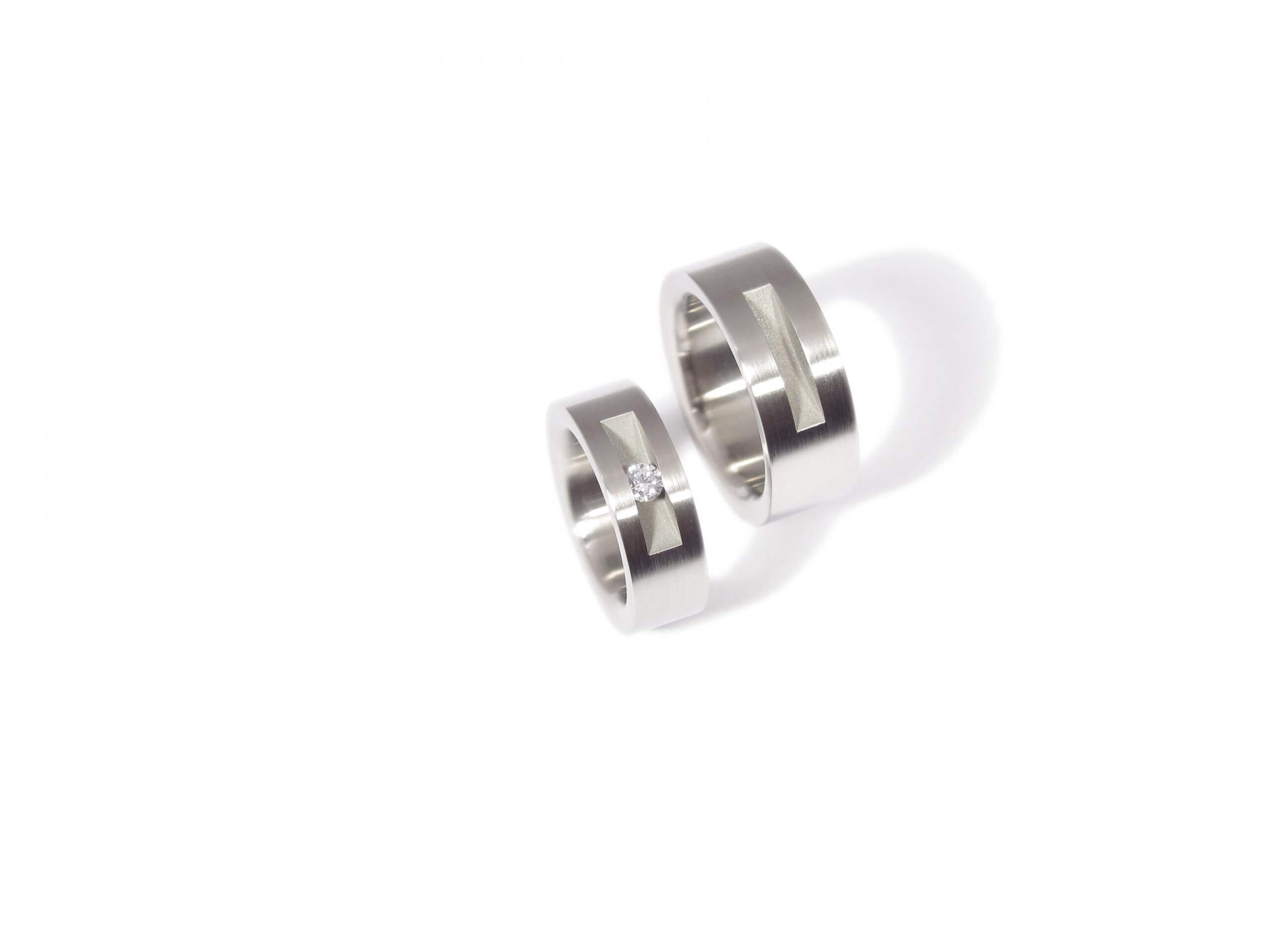 Wedding rings from stainless steel with a white diamond. WR.9.005