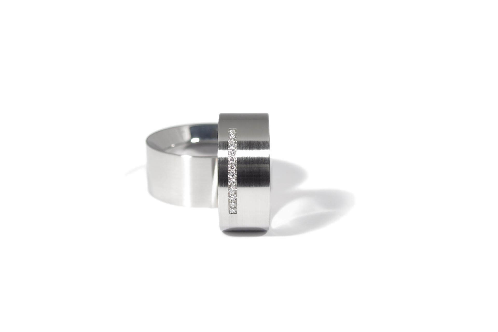 Stainless steel wedding rings with a row of diamonds. WR.9.001-2