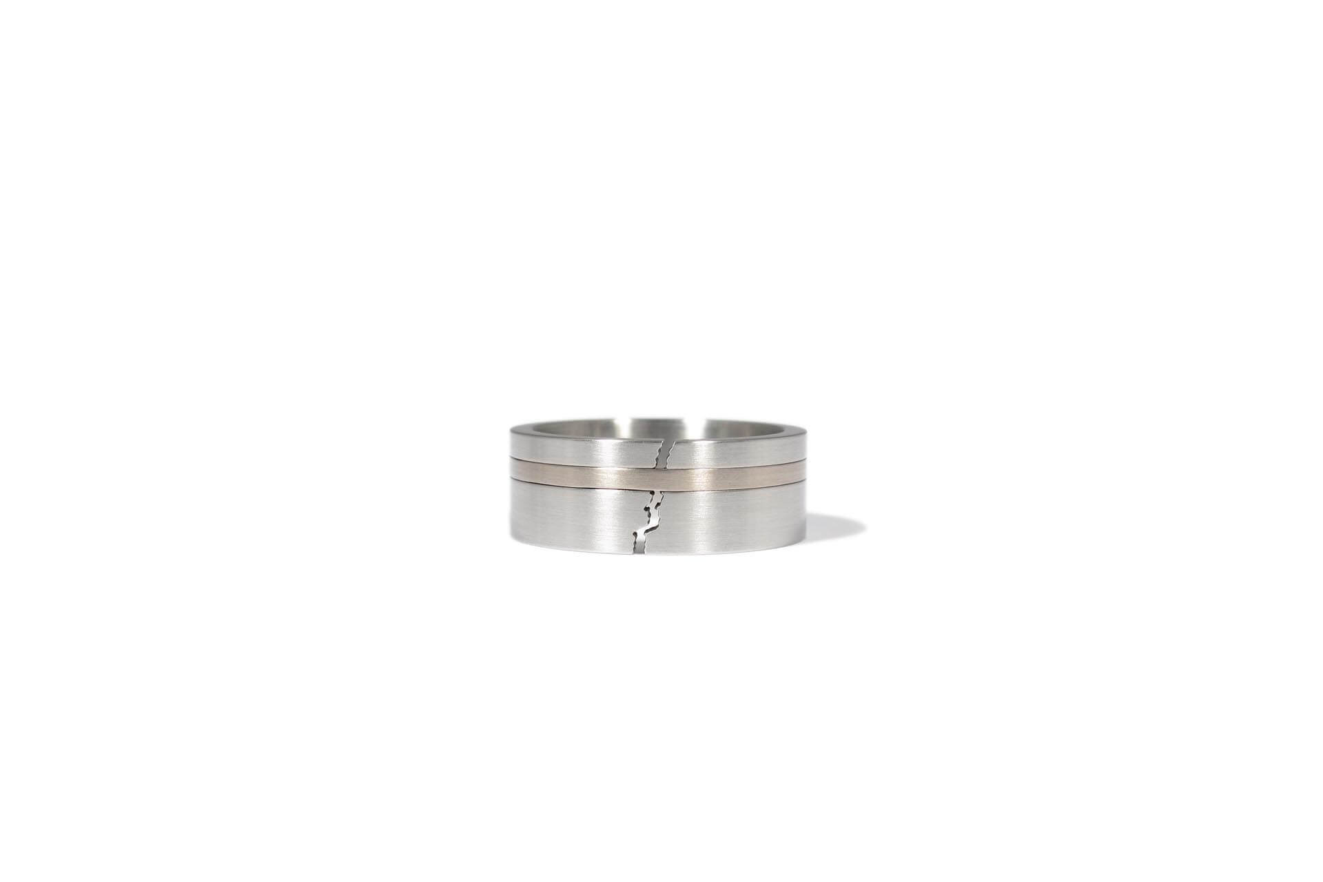 Patrick Malotki ring with a band of white gold.