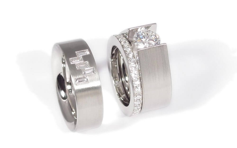 Custom wedding rings from Philip and Stacy. Platinum bands featuring brilliant and baguette cut diamonds.