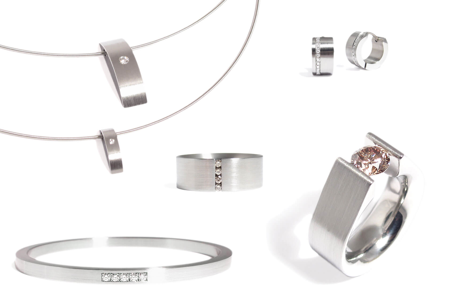 Beautiful jewelry ideas in stainless steel featuring white and champagne diamonds.