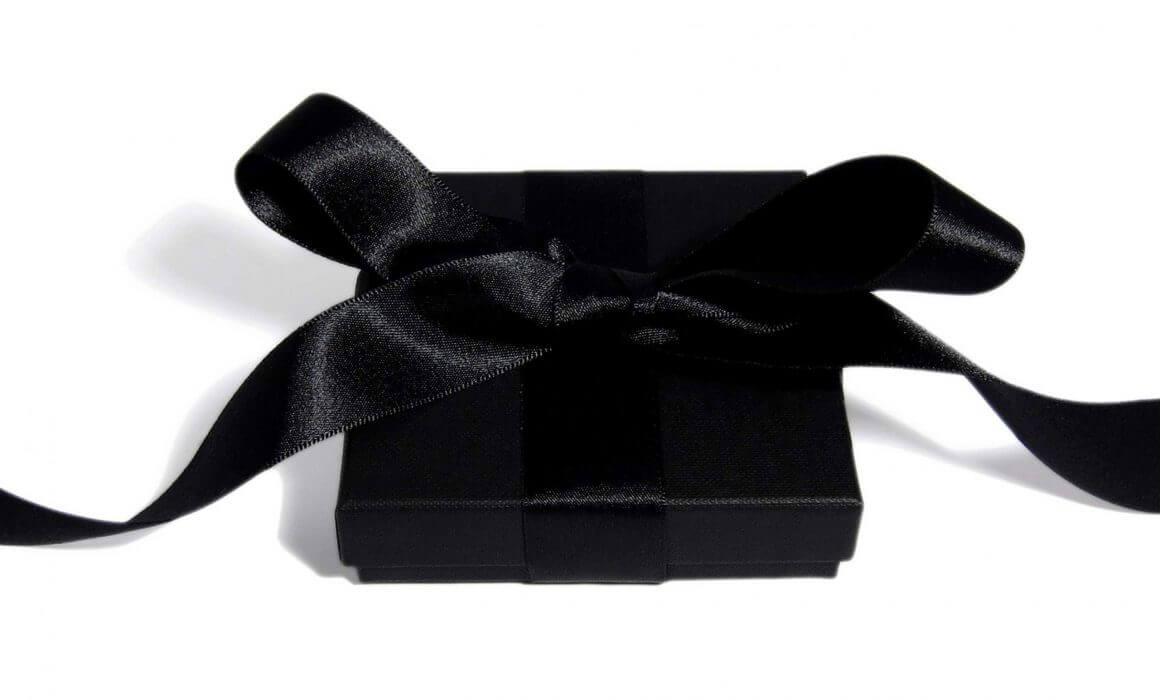 Beautiful wrapped black jewelry box in a black satin ribbon.